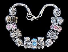 Trinkets-Macro Mondays (Chriscarma) Tags: bracelet jewellery macro closeup darkbackground highcontrast trinkets mac macromondays lowkey