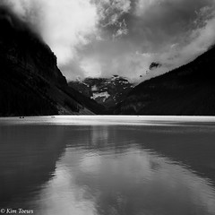Lake Louise, Banff National Park - Alberta, Canada (Kim Toews Photography) Tags: canon rockies canadianrockymountains nationalpark boating canadianrockies glacierwaters glacier travel monochrome blackandwhite bw reflection moody cloud canoe water lake lakelouise mountain parkscanada canadiannationalparks banffnationalpark canada alberta kimtoews naturallight outdoor landscape sky