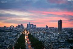 France | Sunset over La Défense in Paris (Nicholas Olesen Photography) Tags: paris france la defense sunset evening sky red clouds city horizontal street cars arc de triomphe travel nikon d7100