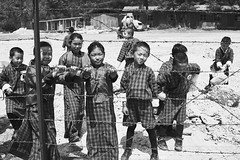 Bhutan: School Children of Haa Valley I. (icarium82) Tags: bhutan drukyul himalayas travel captureone child haavalley localpeople rural traditionalclothing traditionaldress sonydscrx1rm2 schoolchildren street sundaylights