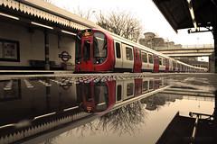 Mirror reflection at West Kensington Station (Luke Agbaimoni (last rounds)) Tags: london londonunderground londontube train trains transportforlondon rainy wet