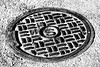 Manhole cover (Thad Zajdowicz) Tags: zajdowicz wheaton maryland usa brooksidegardens manholecover iron metal street fineart circle oval curves rim patternlines blackandwhite pattern black white monochrome bw canon eos 7d dslr digital availablelight lightroom highcontrast ef24105mmf4lisusm
