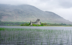 Kilchurn Castle (ed027) Tags: ifttt 500px castle water ancient history ruins historical weather rain mist fog misty foggy beautiful beauty nature lake pond reflection cloud cloudy green rock brick old wet united kingdom highlands hike raw mountain hill