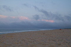 Low Clouds Moving In (brucetopher) Tags: beach water clouds landscape couple people man woman sit gaze watch tourism tourist tour travel vacation holiday waves sea ocean atlantic coean sand wave surf