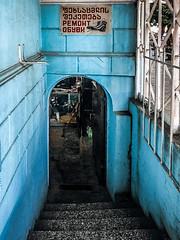 Shoe repair (Melissa Maples) Tags: batumi batum ბათუმი adjara აჭარა georgia gürcistan sakartvelo საქართველო asia 土耳其 apple iphone iphonex cameraphone spring archway doorway blue georgian text sign staircase steps stairs