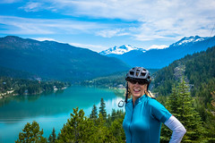 Lori enjoying the view of Green Lake in Whistler after riding to the view point.