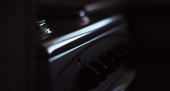 Supper Time ? (Phosphorescent - [fos-fuh-res-uh nt]) Tags: electriccooker cooker oven lowkey reflection light greatlight shadows hob cooking supper meals