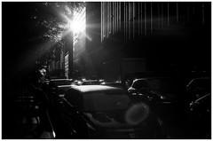 Traffic  (Film) (Harald Philipp) Tags: architecture urban city street cars truck lorry tree traffic people tourism tourist destination travel blackandwhite bw monochrome schwarzweiss grauzone nocolor dark shadows contrast kodakretina retinaiiic classiccamera rangefinder antiquecamera foldingcamera ilford delta400 35mm film analog analogue filmphotography primelens lensflare daytime reflection sun unitedstates northamerica usa manhattan newyork bigapple skyscraper urbancanyon trafficjam starburst sunburst glass blackwhite
