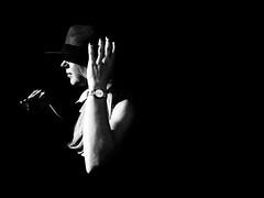 Into the dark (mr.reverend) Tags: lights shadows dark contrast woman hat arms clock street streetphoto streetphotography streetlife urban urbanlife candid city citylight rome italy blackandwhite monochrome