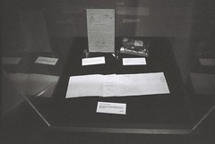 Ismay's Items (goodfella2459) Tags: nikon f4 ilford delta 3200 35mm blackandwhite film analog history titanic exhibition centre byron kennedy hall sydney bruce ismay items checkbook letter spectacles case bwfp