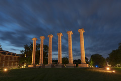 The Columns (Notley Hawkins) Tags: httpwwwnotleyhawkinscom notleyhawkinsphotography notley notleyhawkins 10thavenue mizzou columns thecolumns campus universityofmissouri columbiamissouri bocomo boonecountymissouri july sky clouds cloudysky neutraldensityfilter longexposure grass tree francisquadrangle dusk evening bluehour