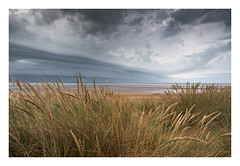 Camber Sands - July 27th (Edd Allen) Tags: sea waves seascape shoreline shore coast coastal tide tidetrails clouds sunset uk england eastsussex sussex south southcoast nikon nikond610 zeiss 18mm atmosphere atmospheric moody serene bucolic rocks storm lightning cambersands rain grass
