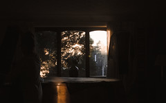 Untitled (Lucy MichaeIa) Tags: window dark light outside inside indoor house evening sun dappled people shadow room home autumn