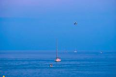 Follow me (Fnikos) Tags: sea water seascape serene blue sky skyline boat sailboat people bay outdoor