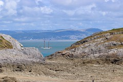 Ship ahoy! (AngharadW) Tags: beach sea clouds hills swanseabay swansea mumbleshead sailingboat angharadw