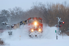 Riding the White Waves (view2share) Tags: cn2631 gecx7328 dash9 dash8 ge generalelectric cn canadiannational 517 l517 cn517 cnl517 snow snowfall snowdrift berm plowberm drift speed crossing signals switch april162018 april2018 april 2018 deansauvola morning westbound westernwisconsin wisconsin wi winter spring springtime storm railway railroading railroads rail rr rails railroaders railroad rring track transportation trains tracks train transport trackage trees freight freighttrain freightcar freightcars manifest minneapolissub stcroixcounty newrichmond locomotive engine recordsnow recordcold