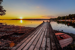 Summer evening (Timo Sutinen) Tags: summer sunset sun water sea pier lauttasaari helsinki boat rocks bay sky wood