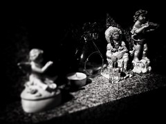 Les porte-bonheur (LUMEN SCRIPT) Tags: visualpoetry visualart shadow light story amerindian indian angel porcelain glass stone material perspective diagonal blur unsharp stilllife naturemorte lowkey monochrome