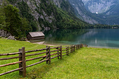 Leading to tranquility (sarah_presh) Tags: lake obersee königsee schonau bavaria germany outdoor fenced wooden hiking boathouse green lush summer nikond750 reflection mountains tranquil berchtesgaden