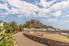 Gorey, or Mont Orgueil, Castle in Jersey. (jack cousin) Tags: 13thcentury channelislands gorey goreycastle jersey montorgueilcastle uk beautiful bluesky boat boats buildings bush cars castle chimney cloud coast colourful flag flagpole flowers fortification grass harbor harbour holiday houses lamppost lowtide medieval palmtree path pier quay resort roofs sand seashore seaside seawall seaweed shrub sky stonework tranquility trees vacation wall nikond610 on1photos