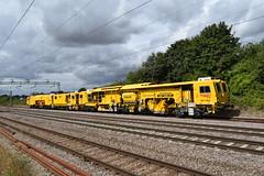 Sunshine Yellow and Cloudy Skies (davidvines1) Tags: railroad railway rail train diesel locomotive networkrail tamper yellow cloud sky