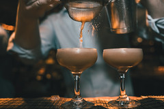 Splashy Coctail (Bokehlicious Harold) Tags: coctail bartender splash espresomartini pouring serving bar light tills orange toning color grading