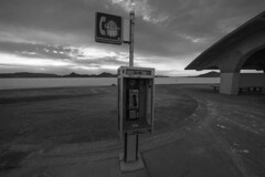 Ill Communication (JasonCameron) Tags: west desert utah rest stop truck black white bw monochrome sunset sundown dusk clouds phone booth relic