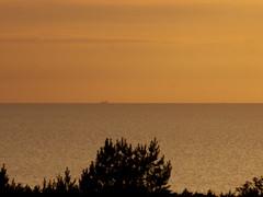 a ship (Darek Drapala) Tags: ship shine shinihg sun sky silhouette sunset skyskape sea seashore seascape panasonic poland polska panasonicg5 baltic nature lumix light water waterscape waterreflects