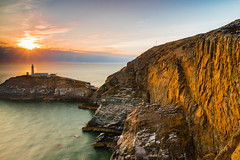 Nearly Sunset (alan.dphotos) Tags: anglesea northwales sunset southstack scenic landscape seascape sea shore rock boat sky cliffs guillemott cliff lighthouse grass water ocean bay
