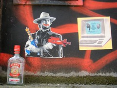 Manchester street art = Clint likes vodka ??? (rossendale2016) Tags: ugly bad good soda iced ice tonic mixer concentrated brewed brewery scotland distilled wall abandoned left propped alcoholic drink popular percentage high cheap strong top screw spirits alcohol greater coty iconic icon litter placed discarded resting consumed drunk vodka actor old computer monitor television tv guns gun empty bottle gin cowboy harry dirty star film eastwood clint centre city quarter northern poster art street manchester