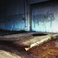 Headlight on wall (ADMurr) Tags: la eastside industrial wall night light blue orange puddle paint cement rolleiflex 35 e zeiss planar kodak ektar ccc775edit