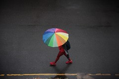IMG_9308 (JetBlakInk) Tags: umbrella rain women streetphotography colours subjecttoground road rainyseason highvantagepoint highelevation