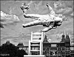 The Astronaut. (alamsterdam) Tags: amsterdam museumplein astronaut monochrome bird rijksmuseum chair