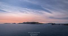 Empty Islands (TheWildFireOne) Tags: landscape sunset ireland islands water peninsula rocks dingle summer ocean coastalfeature blue red sea sky seascape coast kerry cosatal clouds
