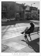 Woman on Sunny Bench (G Dan Mitchell) Tags: pasadena street urban woman sit bench sidewalk winter light shadows blackandwhite monochrome southern california usa north america