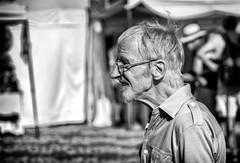 A hair raising experience. (Mister G.C.) Tags: blackandwhite bw image streetshot streetphotography photograph candid people portrait profile man male guy unposed monochrome urban town city sonya6000 sonyalpha a6000 mirrorless telephoto zoom lens sel18105 18105mm sonyglens sony18105mmepz f4 mistergc schwarzweiss strassenfotografie niedersachsen lowersaxony deutschland europe