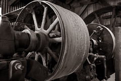 Stamp Mill Power (CameraOne) Tags: belt beltdrive wheel power stampmill mine goldmine silvermine 1800s bodie bodieghosttown california owensvalley abandoned urbandecay ruins historic statepark raw sepia monochrome black white cameraone worn machinery mill miningequipment canon6d wideangle canonef1740mm steampower handheld 110thsec