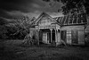 Open Door (Mike Schaffner) Tags: abandoned architecture bw blackwhite blackandwhite clouds decay decayed derelict deserted dilapidated home house monochrome old oncewashome ruins tinroof victorian