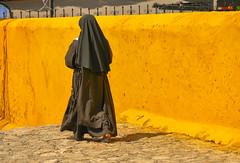 The naked heel (Adaptabilly) Tags: mexico yucatán izamal travel woman mx nun wall yellow lumixgx7
