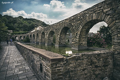 Stavronikita aquaduct (kzappaster) Tags: stonebridge bridge aquaduct athos macedonia greece monastery stavronikita samsung samsungnx100 samsungnx nx100 nx mirrorless compactsystemcamera 16mm 16mmf24 ifn pancake