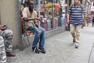 Guy sat on the sidewalk