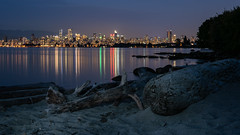 Beachcomber City (Sworldguy) Tags: beachcomber vancouver beach landscape longexposure lightpainting reflections cityscape city lights canada coastal shore englishbay logs driftwood sandy lorcarnobeach nightscene nightime sonya73 wideangle