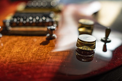 Minor repairs (herecomesanothersongaboutmexico) Tags: guitar macro glossfinish bokeh music stringedinstruments