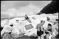 (The Ladies Resort) (Robbie McIntosh) Tags: leicamp leica mp rangefinder streetphotography 35mm film pellicola analog analogue negative leicam summicron analogico leicasummicron35mmf20iv blackandwhite bw biancoenero bn monochrome argentique summicron35mmf20iv autaut dyi selfdeveloped filmisnotdead leicasummicron35mmf2iv strangers candid onthebeach bathers summertime summer sand beach naked belly dive diver adoxchs25 adox rodinal colonnaspezzata