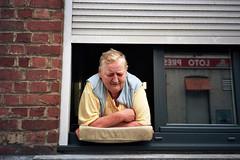 françoise (michel nguie) Tags: michelnguie film analog portrait face mamie granny roubaix rbx window reflet mirror reflection redbricks vitre pane lady woman loto pmu bar