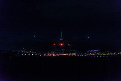 Landing at night (kuyu-peach) Tags: 2015 itm nikond750 rjoo tamron air vehicle airplane airport runway architecture building exterior built structure city cityscape copy space crowd flying illuminated light lighting equipment transportation nature night outdoors sky spectator travel