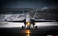 Cold, Dark, Morning Taxi (steviebeats.co.uk) Tags: swiss air force f18 f18c hornet dark morning winter frozen shelter runway taxi light warm