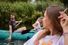 Pardon My French (OlivierVanIsle) Tags: water kayak cigarette smoke puishaven tlburg netherlands nl dutch nikon nikondigital d3300 nikond3300 bush bushes shrubs green splash river