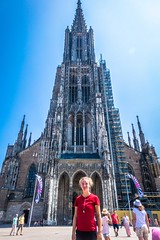 Stephanie standing in front of the worlds tallest church. The tallest church in the world is the Ulm Minster, the main Lutheran congregation in Ulm, Germany.