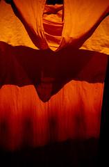 Monk robes (Rolandito.) Tags: orange robe monk laos luang prabang